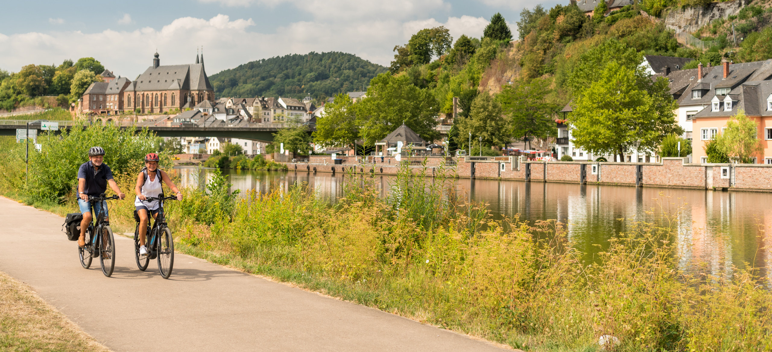 Cycling along the Saar river near Saarburg, Moselle