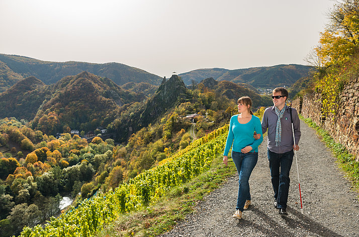 A couple walking along the Ahr valley path near Altenahr, in the Ahr valley